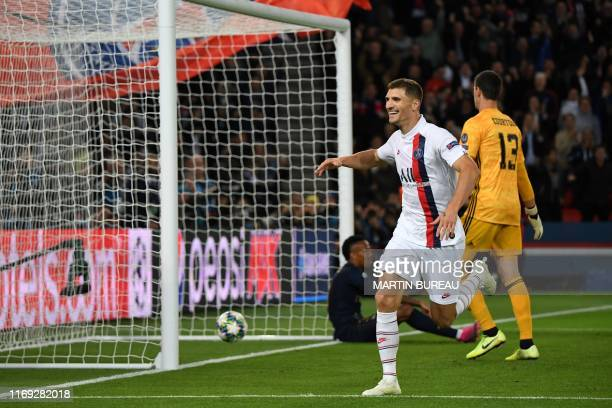 Paris Saint-Germain's Belgian defender Thomas Meunier celebrates after scoring a goal during the UEFA Champions league Group A football match between...
