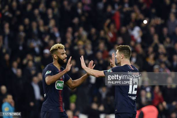 Paris Saint-Germain's Belgian defender Thomas Meunier celebrates with Paris Saint-Germain's Cameroonian forward Eric Choupo-Moting celebrates after...