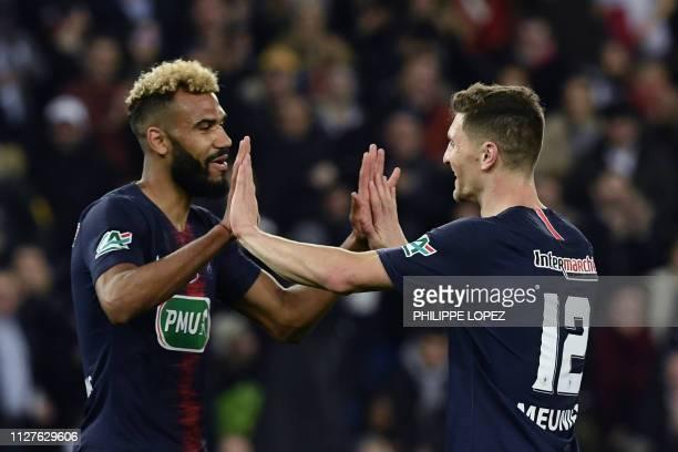 Paris SaintGermain's Belgian defender Thomas Meunier celebrates with Paris SaintGermain's Cameroonian forward Eric ChoupoMoting celebrates after...