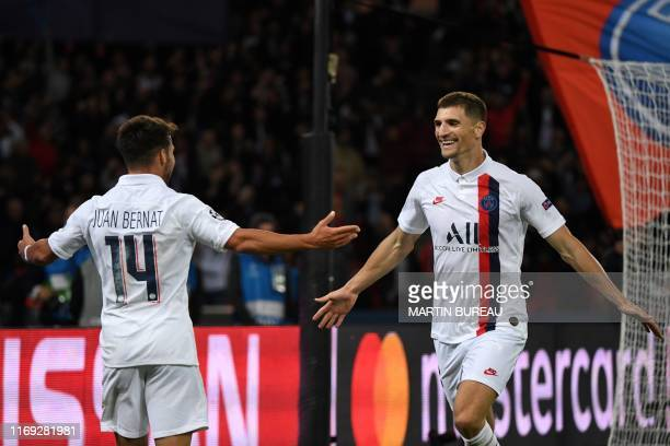 Paris Saint-Germain's Belgian defender Thomas Meunier celebrates with Paris Saint-Germain's Spanish defender Juan Bernat after scoring a goal during...