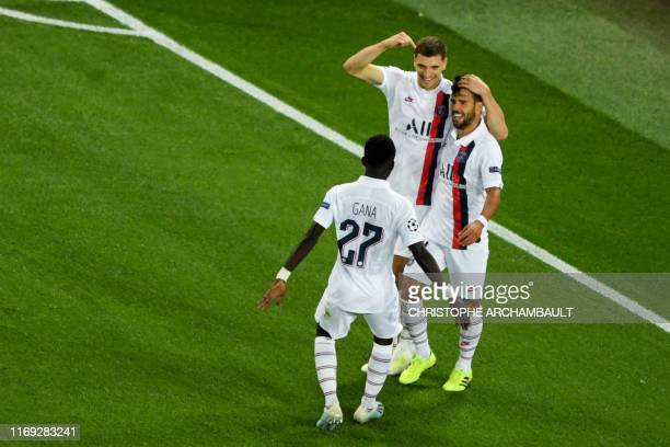 Paris SaintGermain's Belgian defender Thomas Meunier celebrates with Paris SaintGermain's Spanish defender Juan Bernat and Paris SaintGermain's...