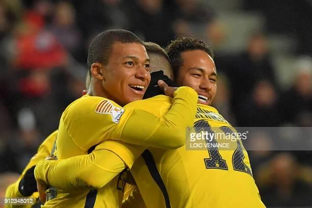 Paris Saint-Germain's Belgian defender Thomas Meunier celebrates with Paris Saint-Germain's Brazilian forward Neymar and Paris Saint-Germain's French...