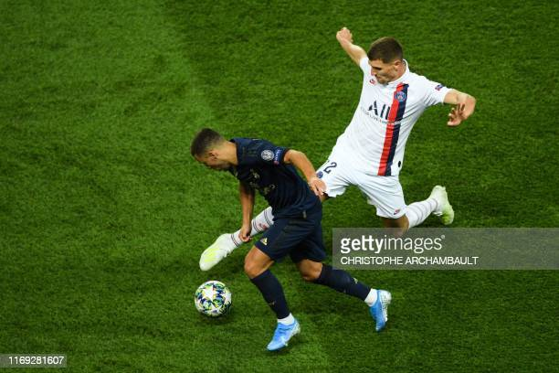 Paris Saint-Germain's Belgian defender Thomas Meunier fights for the ball with Real Madrid's Belgian forward Eden Hazard during the UEFA Champions...