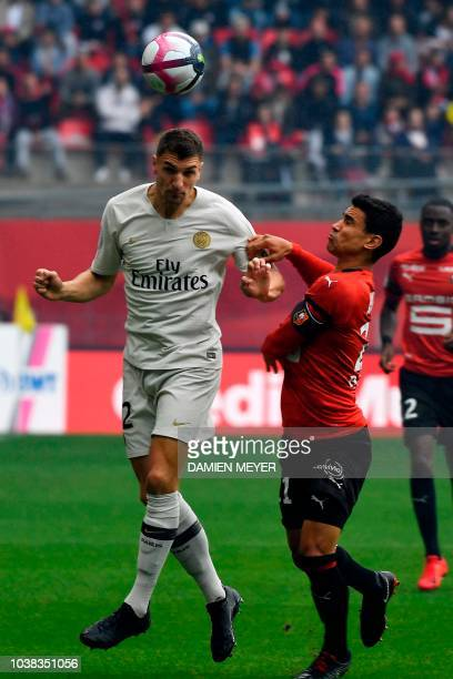 Paris SaintGermain's Belgian defender Thomas Meunier heads the ball past Rennes' French midfielder Benjamin Andre during the French L1 football match...