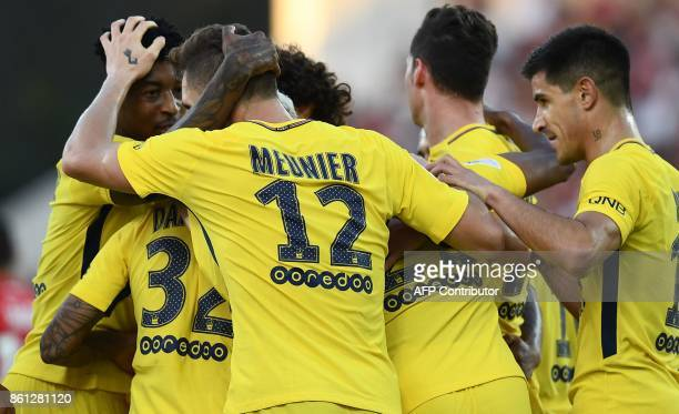 Paris SaintGermain's Belgian defender Thomas Meunier is congratuled by teammates after scoring a goal during the French L1 football match between...