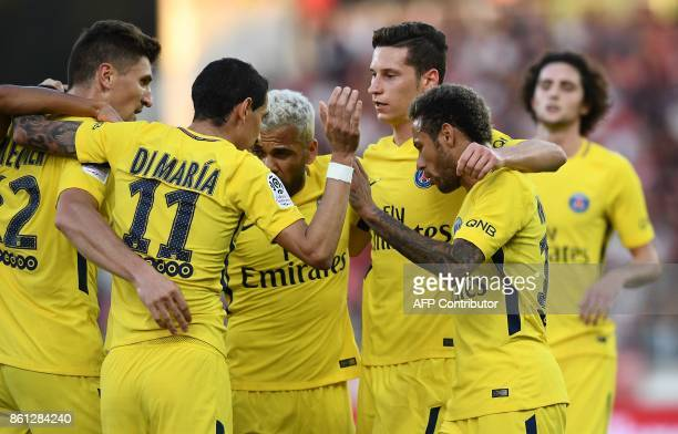 Paris SaintGermain's Belgian defender Thomas Meunier is congratuled by teammates after a goal during the French L1 football match between Dijon and...