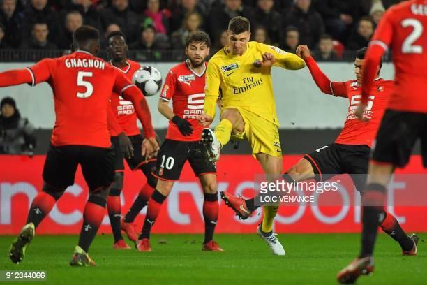 Paris Saint-Germain's Belgian defender Thomas Meunier scores a goal during the French League Cup football semi-final match between Rennes and Paris...