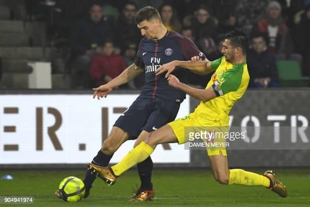 Paris SaintGermain's Belgian defender Thomas Meunier vies with Nantes' Belgian midfielder Joris Kayembe during the French L1 football match between...