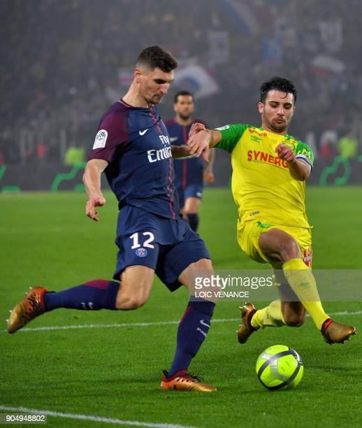 Paris SaintGermain's Belgian defender Thomas Meunier vies with Nantes' French defender Leo Dubois during the French L1 football match between Nantes...