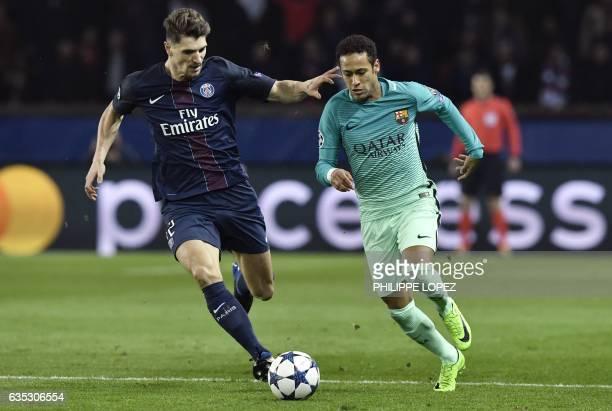 Paris SaintGermain's Belgian defender Thomas Meunier vies with Barcelona's Brazilian forward Neymar during the UEFA Champions League round of 16...