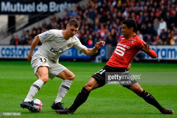 Paris SaintGermain's Belgian defender Thomas Meunier vies with Rennes' French midfielder Benjamin Andre during the French L1 football match between...