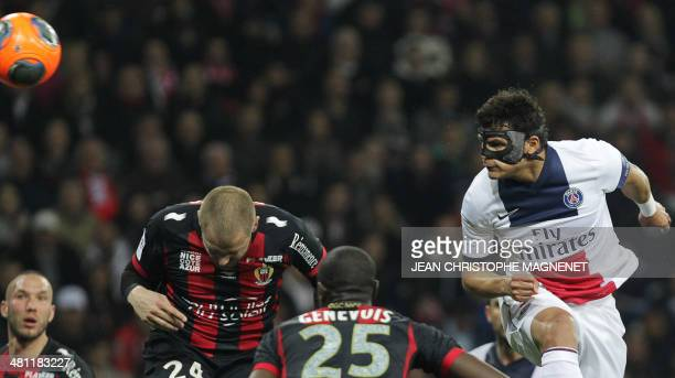 Paris Saint-Germain's Brazilian defender and captain Thiago Silva heads the ball during the French L1 football match between Nice and Paris...