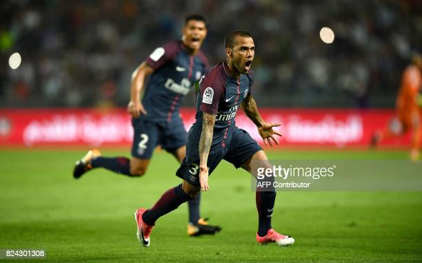 Paris SaintGermain's Brazilian defender Dani Alves celebrates after scoring a goal during the French Trophy of Champions football match between...