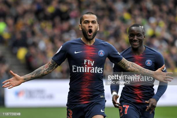 Paris SaintGermain's Brazilian defender Dani Alves celebrates after scoring during the French L1 football match between Nantes and PSG at the...