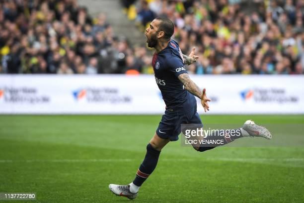 Paris SaintGermain's Brazilian defender Dani Alves celebrates after scoring during the French L1 football match between Nantes and Paris SaintGermain...