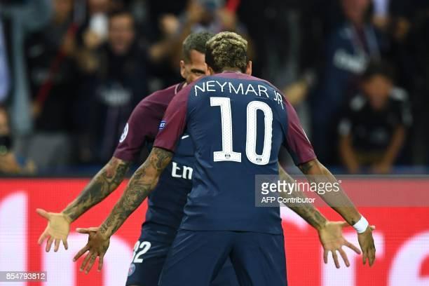 TOPSHOT Paris SaintGermain's Brazilian defender Dani Alves celebrates scoring a goal with Paris SaintGermain's Brazilian forward Neymar during the...