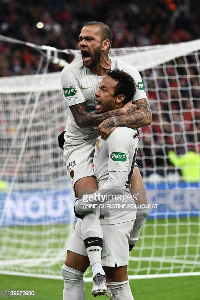 Paris Saint-Germain's Brazilian defender Dani Alves celebrates with his teammate Brazilian forward Neymar after scoring a goal during the French Cup...
