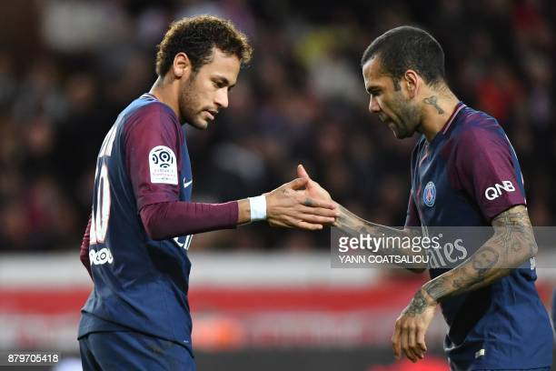 Paris SaintGermain's Brazilian defender Dani Alves congratulates Paris SaintGermain's Brazilian forward Neymar after he scored a penalty kick during...