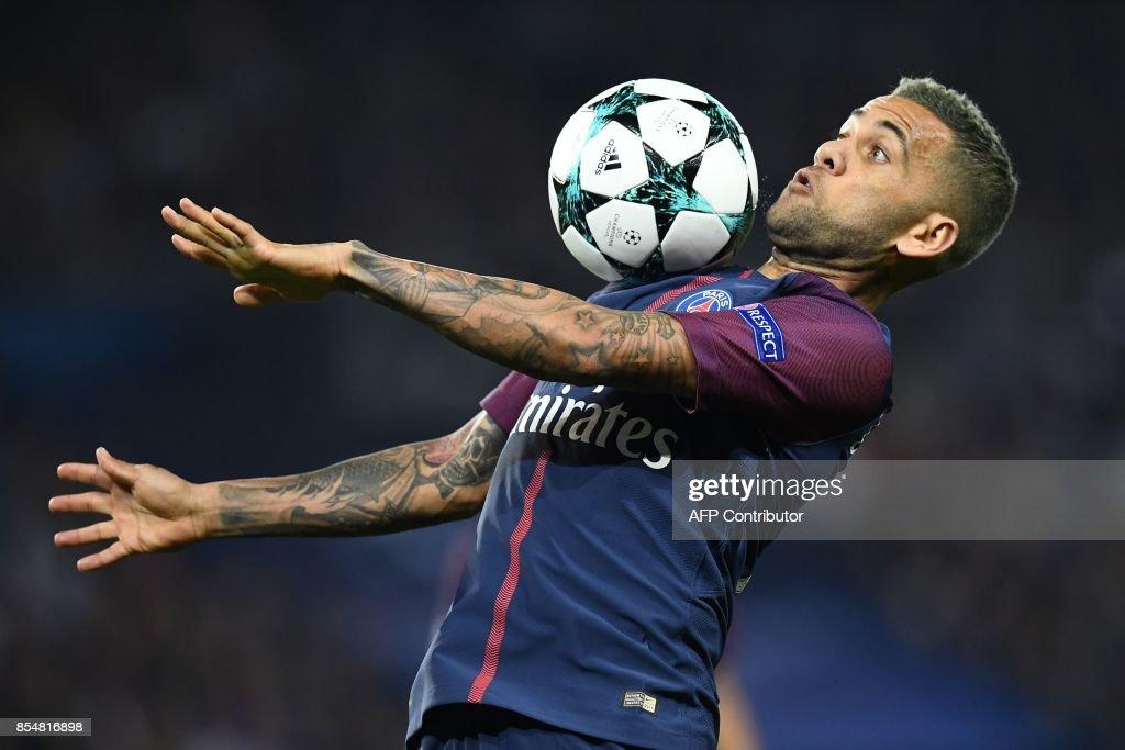 Paris Saint-Germain's Brazilian defender Dani Alves controls the ball during the UEFA Champions League football match between Paris Saint-Germain and Bayern Munich on September 27, 2017 at the Parc des Princes stadium in Paris. /