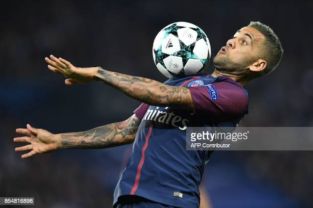 Paris SaintGermain's Brazilian defender Dani Alves controls the ball during the UEFA Champions League football match between Paris SaintGermain and...
