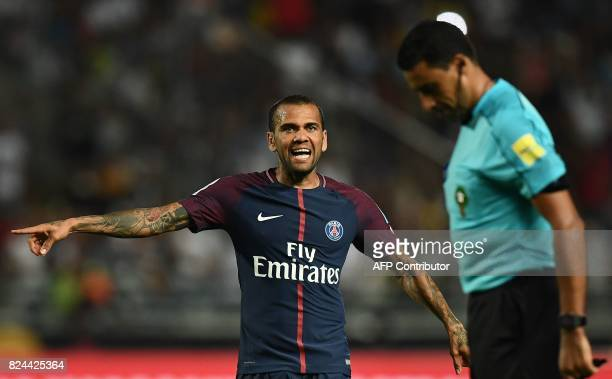 Paris SaintGermain's Brazilian defender Dani Alves gestures to the referee during the French Trophy of Champions football match between Monaco and...