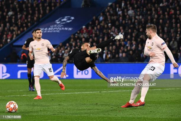 Paris SaintGermain's Brazilian defender Dani Alves jumps for the ball surrounded by Manchester United's Brazilian midfielder Andreas Pereira and...
