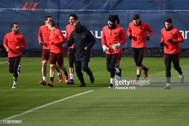 Paris SaintGermain's Brazilian defender Dani Alves Paris SaintGermain's Italian midfielder Marco Verratti an assistant coach Paris SaintGermain's...