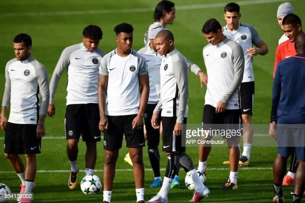Paris SaintGermain's Brazilian defender Dani Alves Paris SaintGermain's French midfielder Christopher Nkunku Paris SaintGermain's French defender...