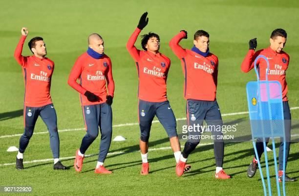 Paris SaintGermain's Brazilian defender Dani Alves Paris SaintGermain's French forward Kylian Mbappe Paris SaintGermain's French midfielder...