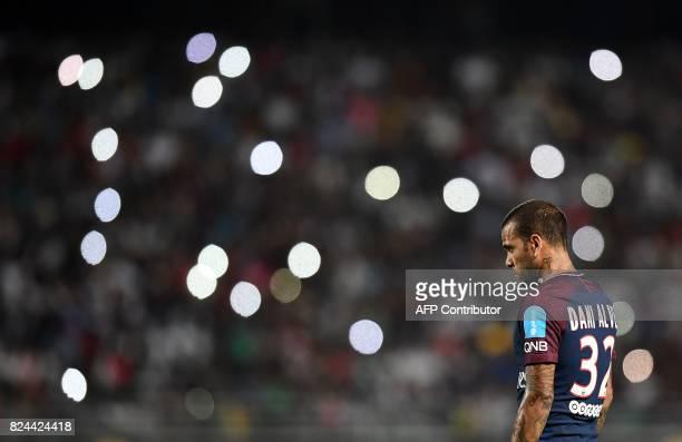 Paris SaintGermain's Brazilian defender Dani Alves reacts during the French Trophy of Champions football match between Monaco and Paris SaintGermain...