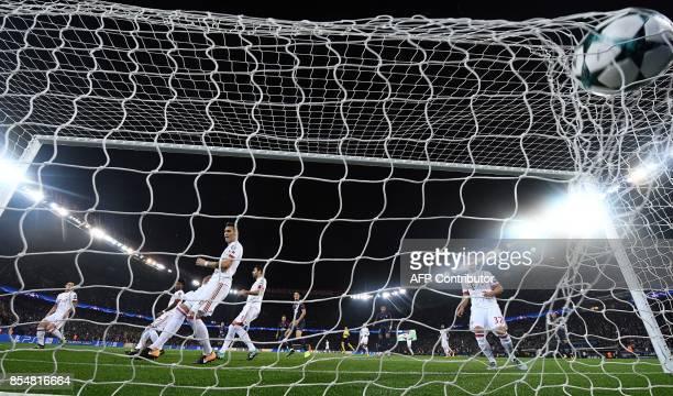TOPSHOT Paris SaintGermain's Brazilian defender Dani Alves scores a goal during the UEFA Champions League football match between Paris SaintGermain...