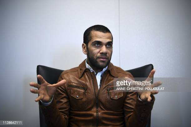 Paris SaintGermain's Brazilian defender Dani Alves speaks during an interview with AFP on March 4 at the club's Camp des Loges training grounds in...