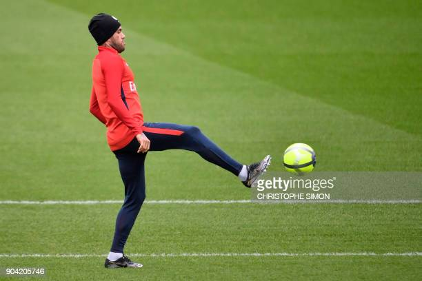 Paris SaintGermain's Brazilian defender Dani Alves takes part in a training session on January 12 2018 at the Camp des Loges in SaintGermainenLaye...