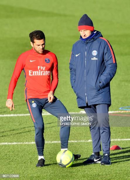Paris SaintGermain's Brazilian defender Dani Alves takes part in a training session eyed by Paris SaintGermain's Spanish head coach Unai Emery at the...