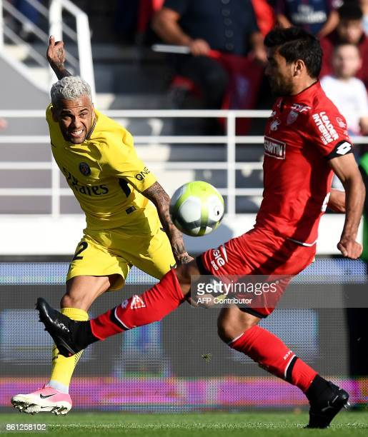 Paris SaintGermain's Brazilian defender Dani Alves vies with Dijon's Tunisian defender Oussama Haddadi during g the French L1 football match between...
