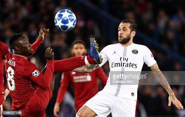 Paris SaintGermain's Brazilian defender Dani Alves vies with Liverpool's Naby Keita during the UEFA Champions League Group C football match between...
