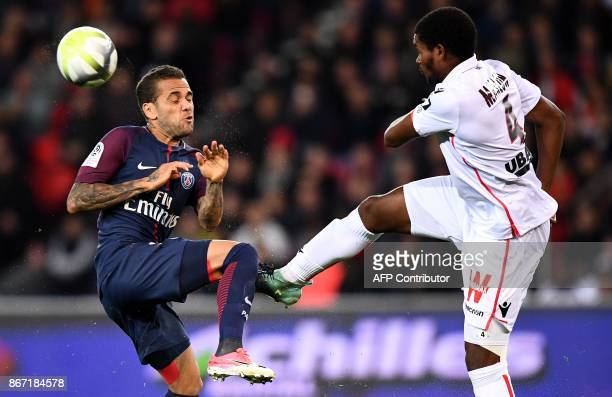 Paris SaintGermain's Brazilian defender Dani Alves vies with Nice's Brazilian defender Santos Marlon during the French L1 football match between...