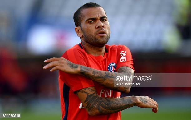 Paris SaintGermain's Brazilian defender Dani Alves warms up ahead of the French Trophy of Champions football match between Monaco and Paris...