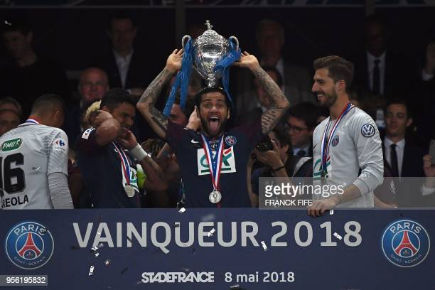 TOPSHOT Paris SaintGermain's Brazilian defender Daniel Alves celebrates with the trophy at the end of the French Cup final football match between Les...