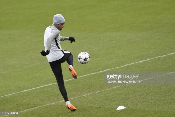 Paris SaintGermain's Brazilian defender Daniel Alves controls the ball during a training session at in SaintGermainenLaye on February 13 2018 on the...