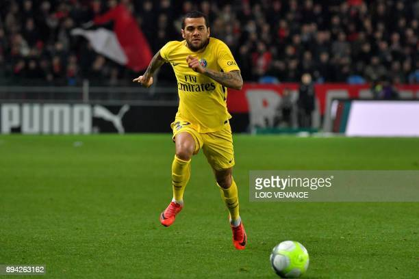 Paris SaintGermain's Brazilian defender Daniel Alves runs with the ball during the French Ligue 1 football match Rennes vs Paris SG on December 16...