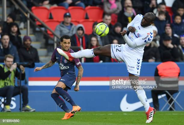 Paris SaintGermain's Brazilian defender Daniel Alves vies with Strasbourg's French defender Kenny Lala during the French Ligue 1 football match...