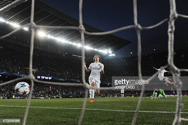 Paris SaintGermain's Brazilian defender David Luiz reacts to Neymar's first goal during the UEFA Champions League quarterfinals second leg football...