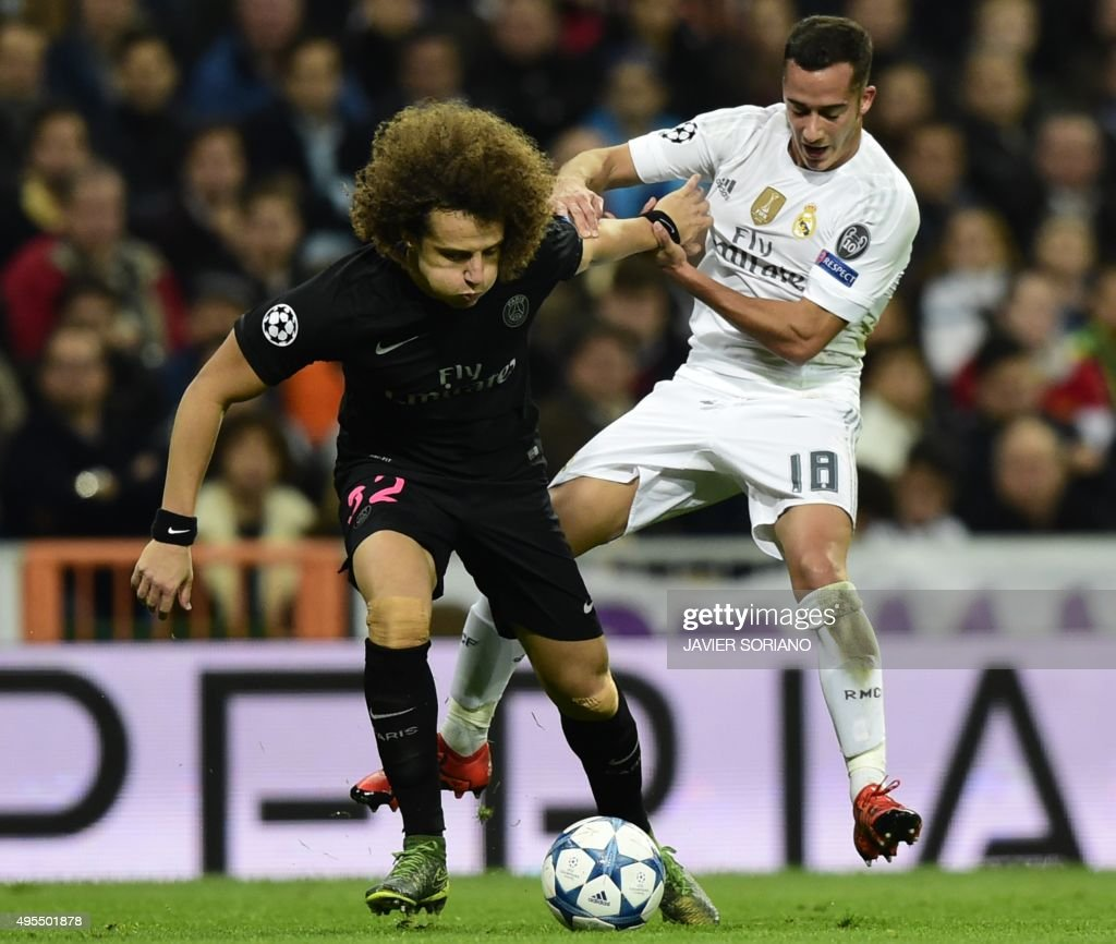 Paris Saint-Germain's Brazilian defender David Luiz (L) vies with Real Madrid's midfielder Lucas Vazquez during the UEFA Champions League football match Real Madrid CF vs Paris Saint-Germain (PSG) at the Santiago Bernabeu stadium in Madrid on November 3, 2015. AFP PHOTO / JAVIER SORIANO