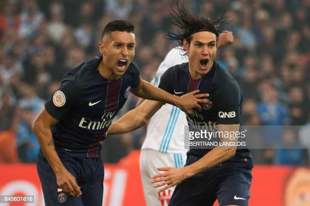 TOPSHOT Paris SaintGermain's Brazilian defender Marquinhos and Paris SaintGermain's Uruguayan forward Edinson Cavani celebrate after scoring a goal...