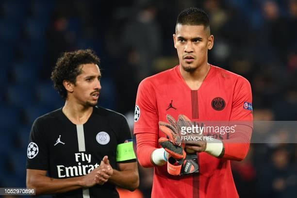 Paris SaintGermain's Brazilian defender Marquinhos and Paris SaintGermain's French goalkeeper Alphonse Areola react at the end of the UEFA Champions...