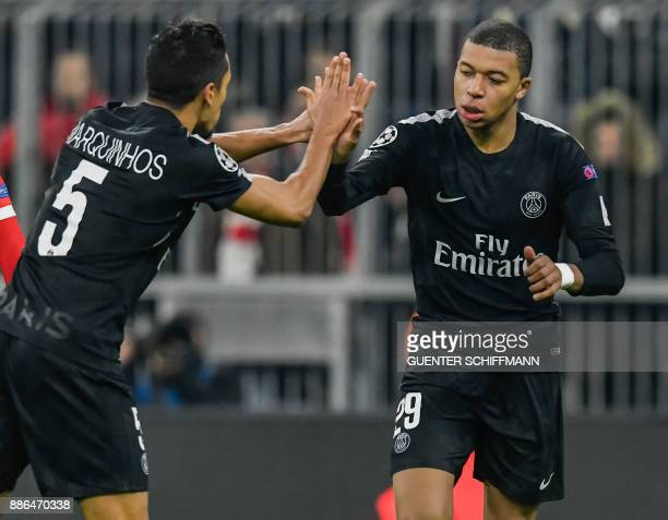 Paris SaintGermain's Brazilian defender Marquinhos and Paris SaintGermain's French forward Kylian Mbappe celebrate the first goal for their team...