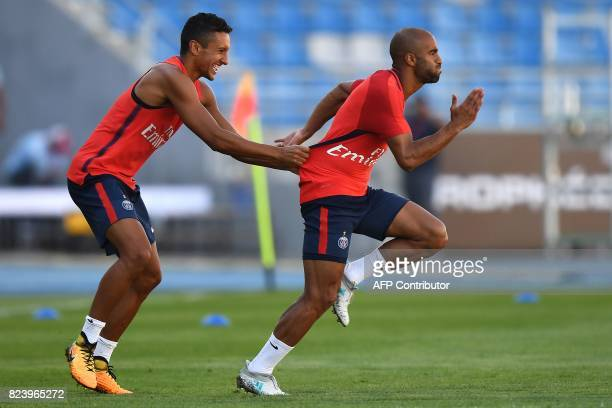 Paris SaintGermain's Brazilian defender Marquinhos and Paris SaintGermain's Brazilian midfielder Lucas Moura take part in a training session at the...