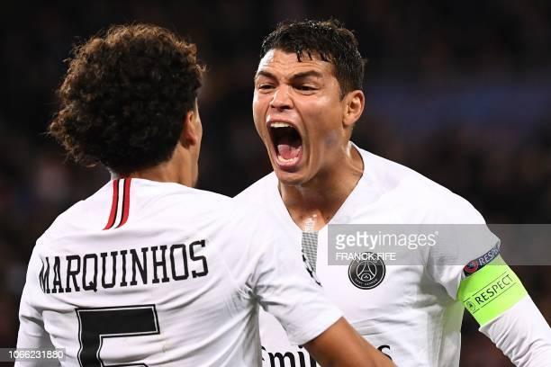 TOPSHOT Paris SaintGermain's Brazilian defender Marquinhos and Paris SaintGermain's Brazilian defender Thiago Silva react during the UEFA Champions...