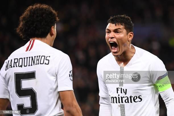 Paris SaintGermain's Brazilian defender Marquinhos and Paris SaintGermain's Brazilian defender Thiago Silva react during the UEFA Champions League...